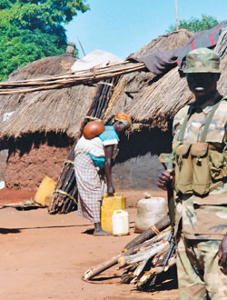 Guard_in_Labuje_IDP_camp,_Uganda 2002.jpg