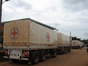 A convoy of trucks with Aid heading out of Gulu-town and into the Bush.