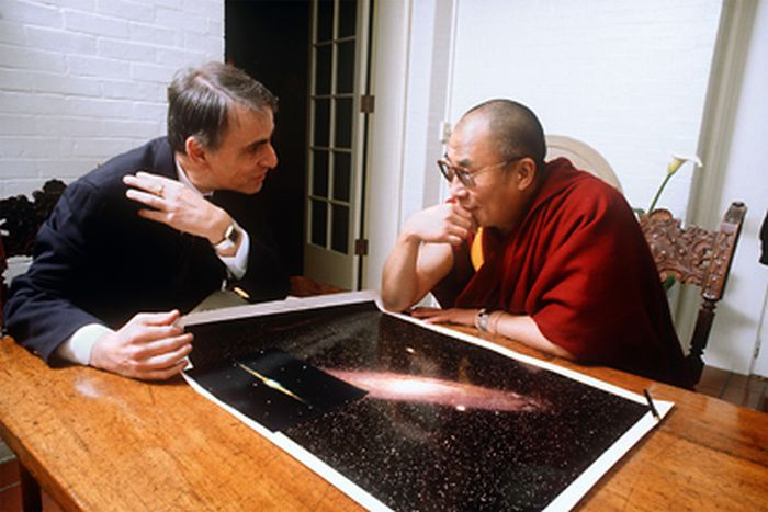 Carl Sagan shows the Dali Lama where his physical being resides in the grand scheme if things.